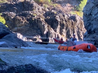 Raft drifts through rapids on the Rogue River.
