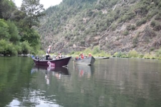 Two of our drift boats on the Rogue River with guests salmon fishing.